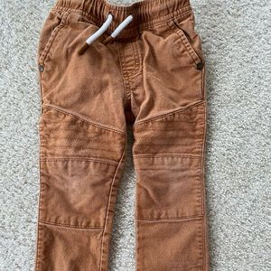 Camel/tan colored jeans with patch and frayed hems